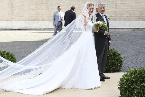 Elisabetta Rosboch von Wolkenstein, who will marry Belgium's Prince Amedeo, smiles as she arrives with her father Ettore as they arrive before the wedding ceremony at Santa Maria in Trastevere
