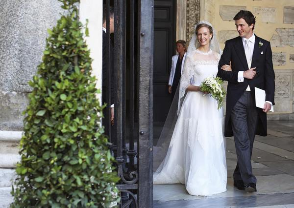 Belgium's Prince Amedeo and his wife Elisabetta Rosboch von Wolkenstein leave at the end of their wedding ceremony in central Rome